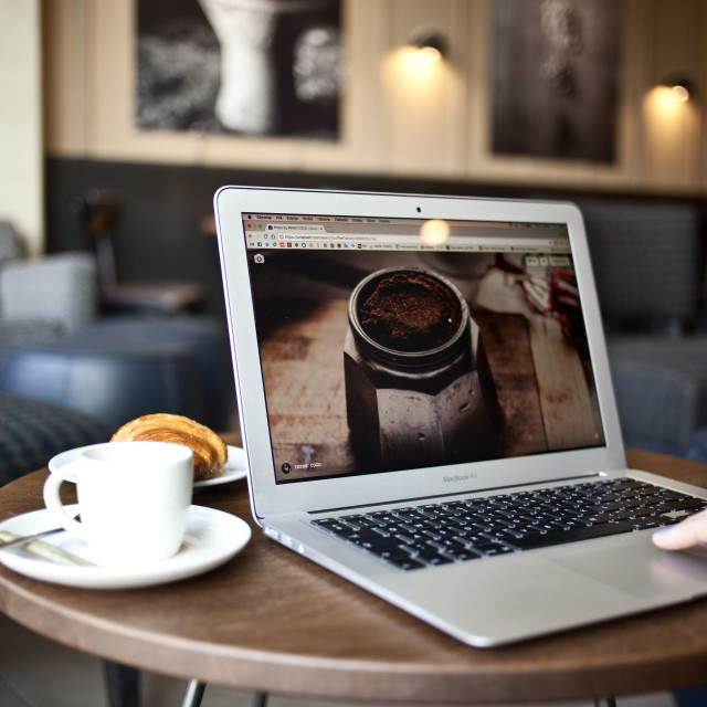 """Macbook Pro and coffee"" stock image"