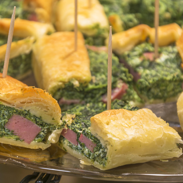 """Slices of quiche ricotta and spinach"" stock image"