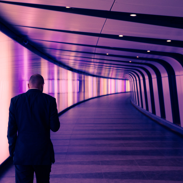 """Businessman in modern city tunnel"" stock image"