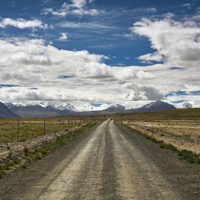 """Tibet Plateau, a road leading to the transfer of snow mountains between China and Bhutan"" stock image"