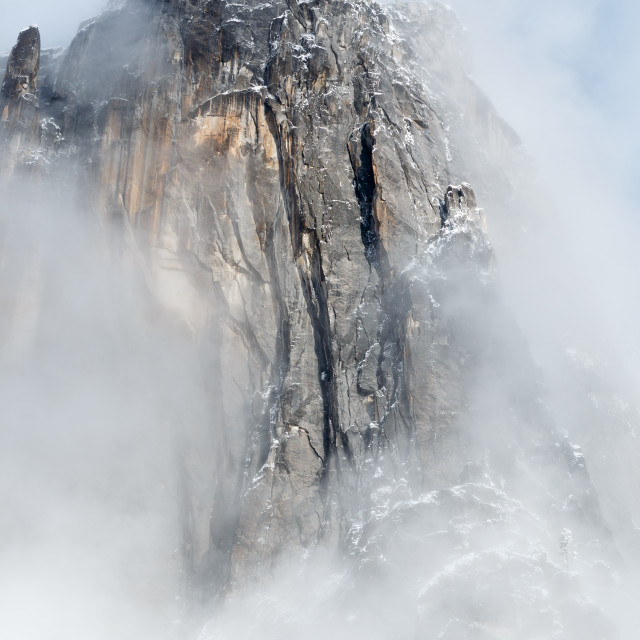 """""""Granite spire surrounded by clouds"""" stock image"""