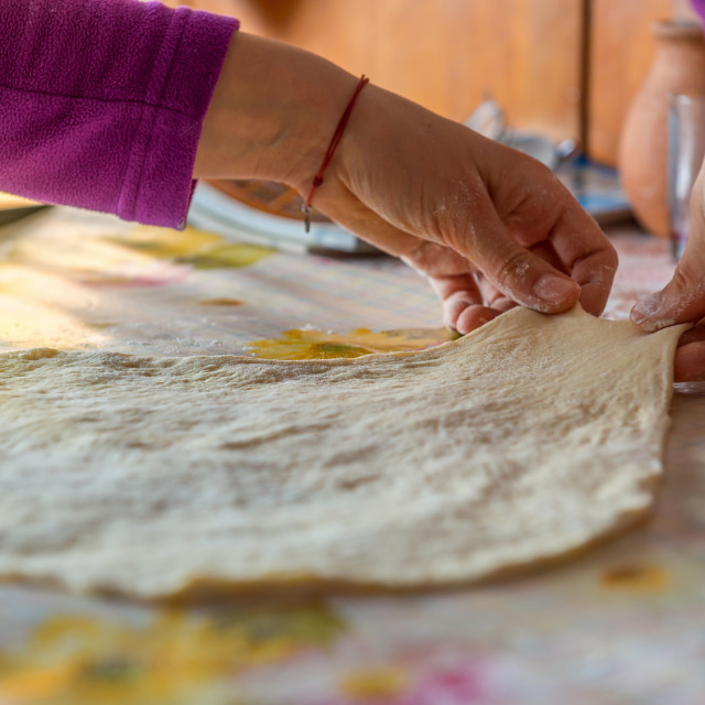 """""""Woman hands kneading dough on the table"""" stock image"""