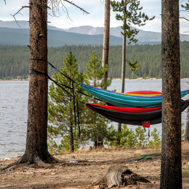 """""""HAMMOCK IN OUTDOORS WITH MOUNTAIN LAKE VIEW"""" stock image"""