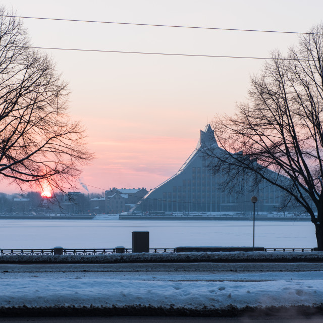 """Winter landscape at sunset with National Library of Latvia at background."" stock image"