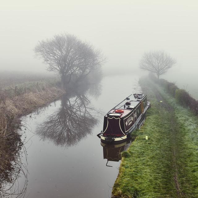 """Narrowboat William moored on a misty morning"" stock image"