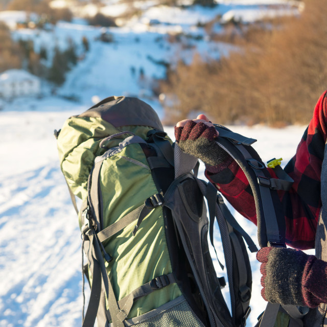 """Man holding backpack on the mountain trip"" stock image"