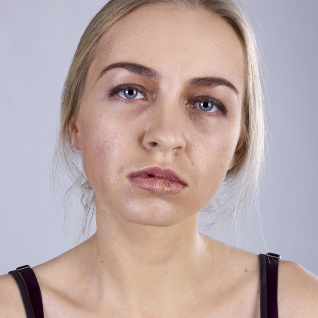 """""""Portrait of a young woman in a gloom"""" stock image"""