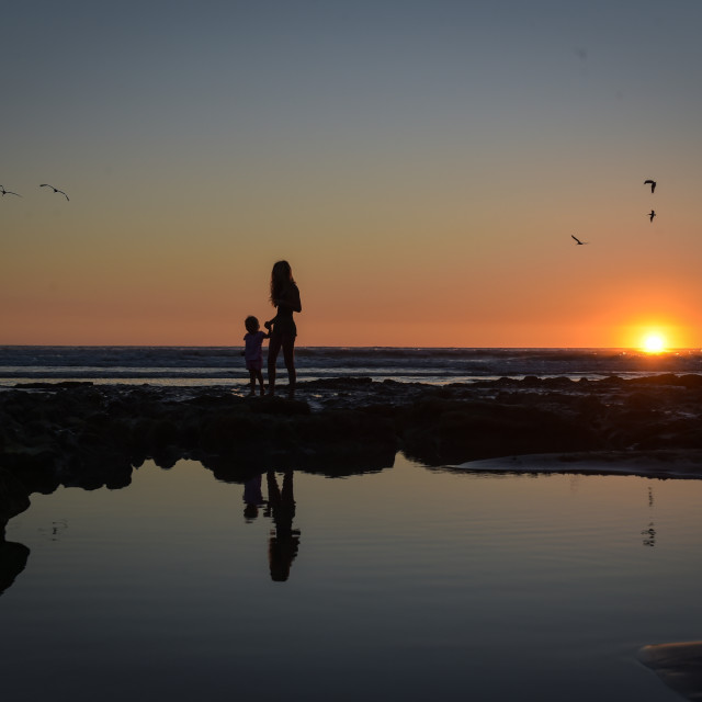 """Mother and Daughter Sunset Two"" stock image"