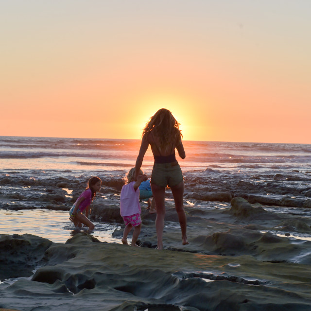 """Mother And Daughter Sunset Three"" stock image"