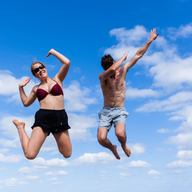 """Girl Boy Jumping Happy Blue"" stock image"