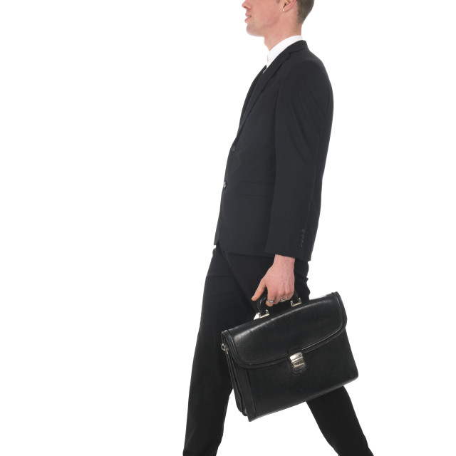 """""""Side view walking business man with briefcase"""" stock image"""