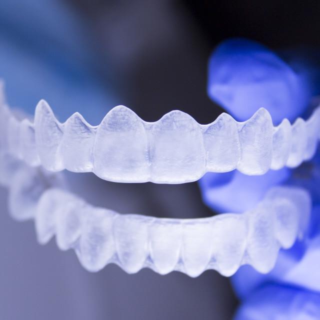 """Dental orthodontics held by dentists hand"" stock image"