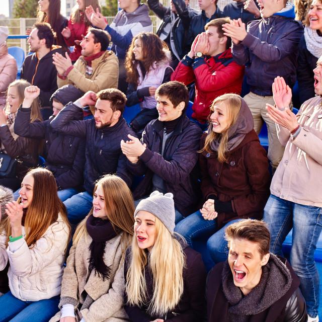 """Cheering fans in stadium people applaud your favorite team."" stock image"