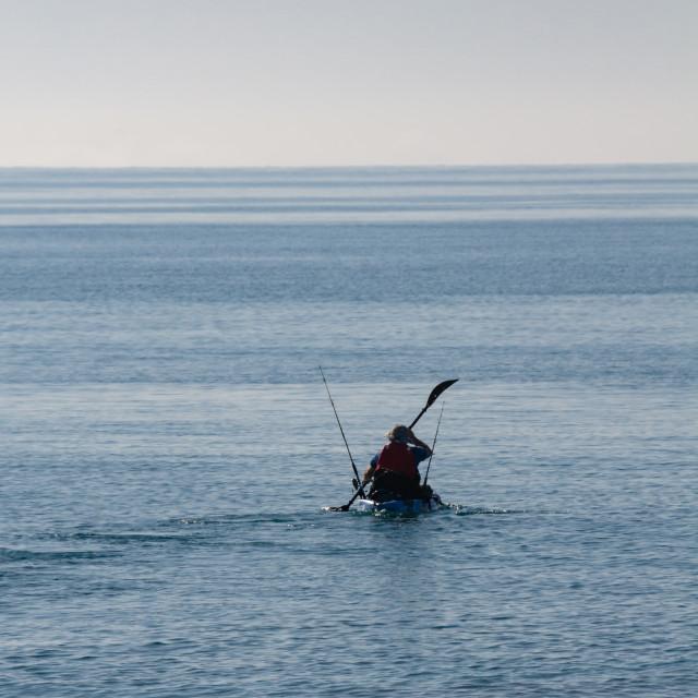 """Canoeist wiht fishing rod, Mediterranean Sea, Spain"" stock image"