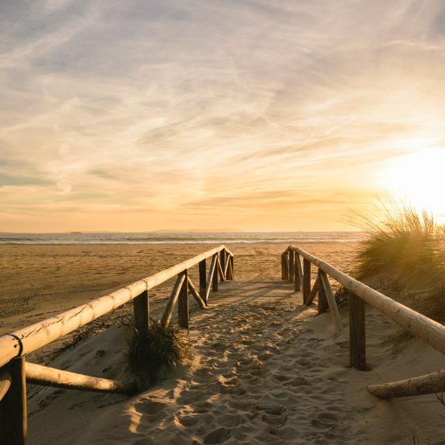 """Path on sand at sunset, Tarifa, Spain"" stock image"