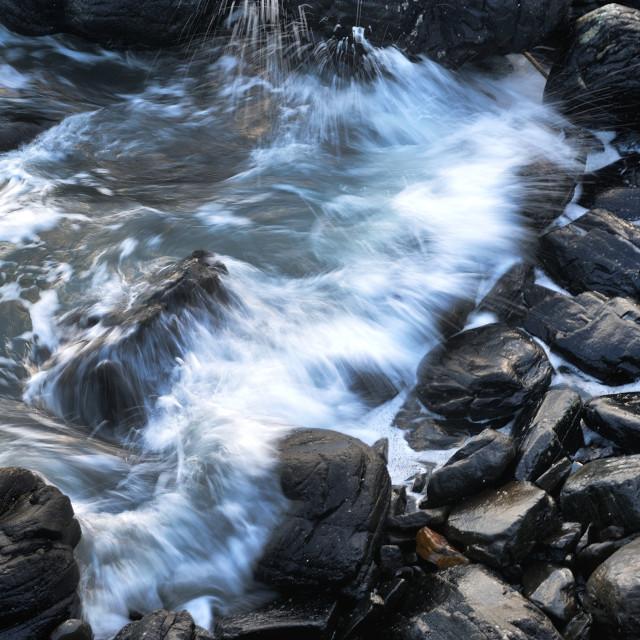"""""""Waves crashing onto rock"""" stock image"""