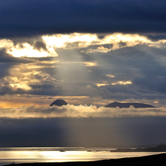 """Light shaft over the water around Skye"" stock image"