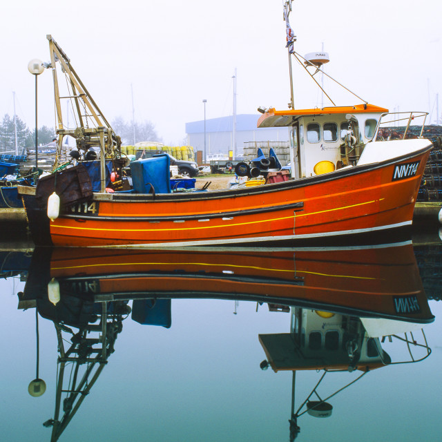 """Fishing boat in Eastbourne Sovereign Harbour"" stock image"