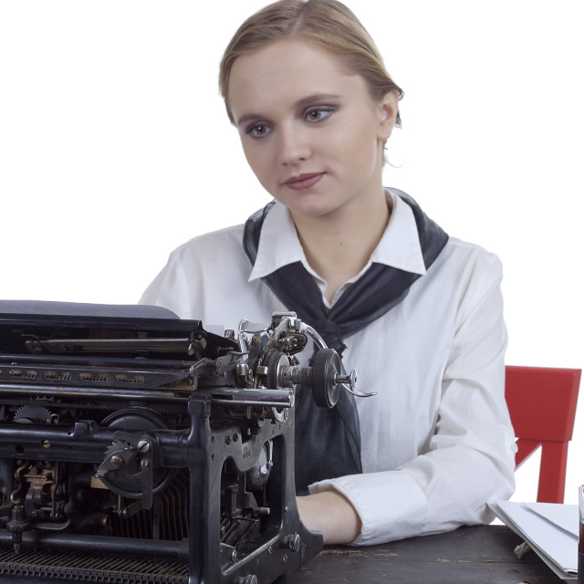 """Young girl typist"" stock image"
