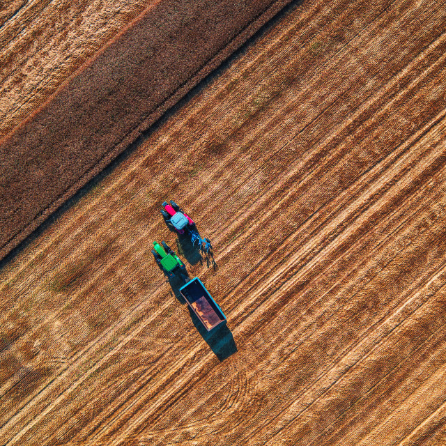 """""""Aerial view of 2 tractors working on the harvest field"""" stock image"""