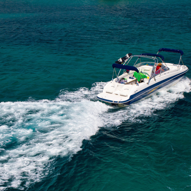 """""""Powerboat on blue open water"""" stock image"""