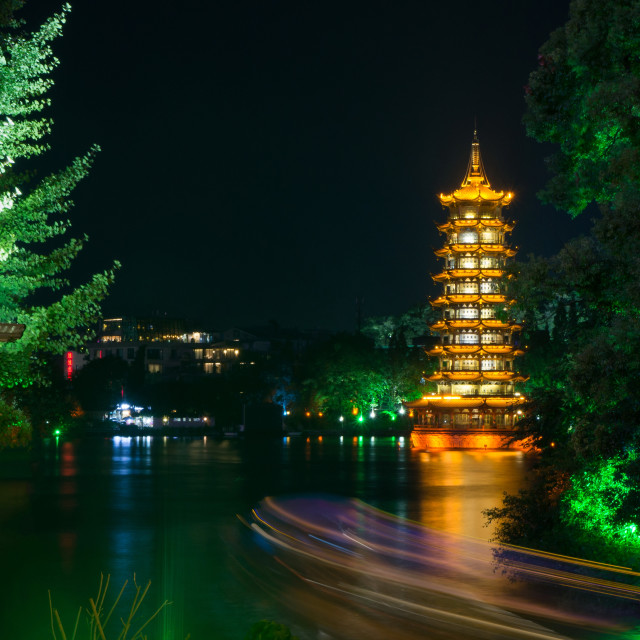 """Guilin tower with light trails from a boat"" stock image"