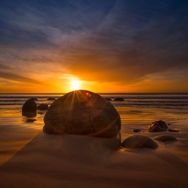 """""""Sunrise at Moeraki Boulders"""" stock image"""