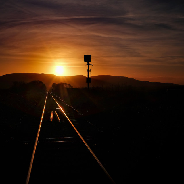 """Remote railway line at sunset"" stock image"