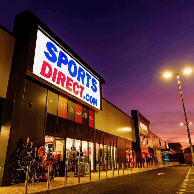 """Sports Direct store at sunset"" stock image"