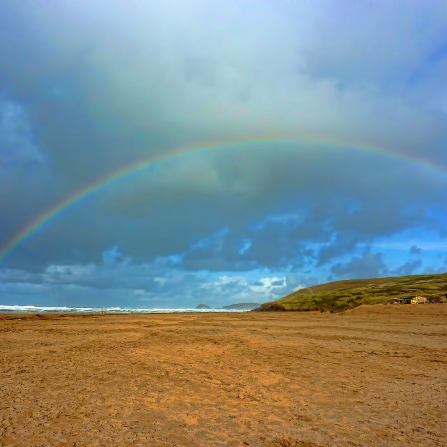 """Rainbow over Perranporth Beach"" stock image"