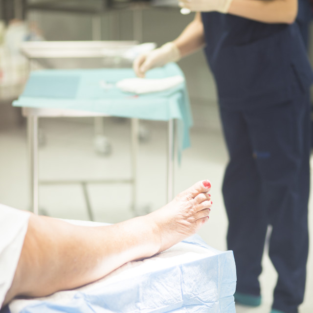 """Patient leg in operating theater"" stock image"