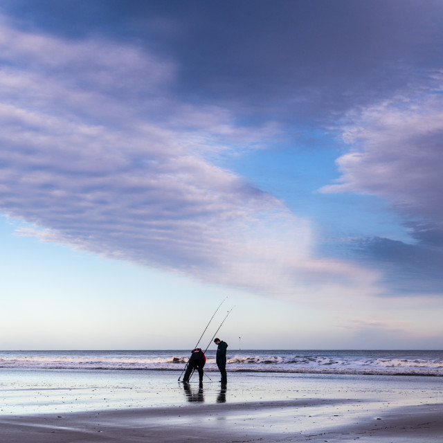 """Fishing on the beach"" stock image"