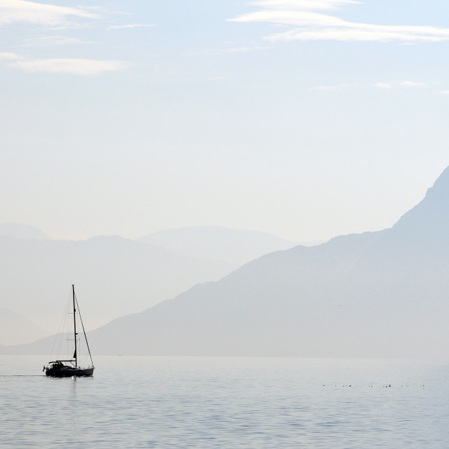 """Yacht leaving harbour at Armadale, Isle of Skye"" stock image"