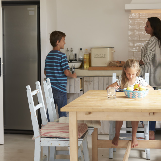 """""""Children Helping To Lay Table For Family Meal"""" stock image"""