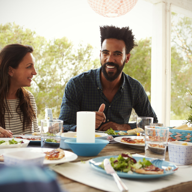 """""""Family Enjoying Outdoor Meal On Terrace Together"""" stock image"""