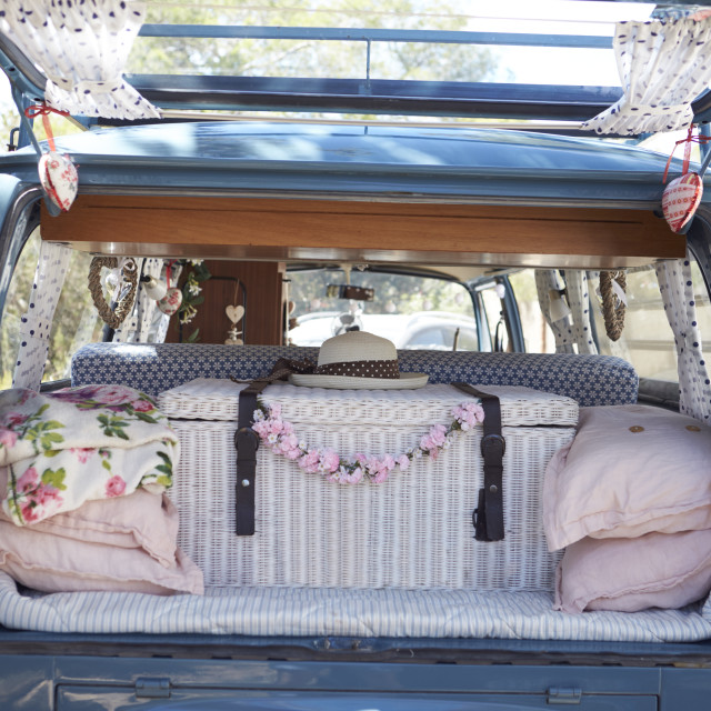 """""""Open back of a retro camper van, with luggage and cushions"""" stock image"""