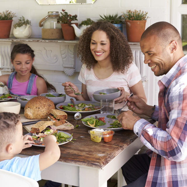 """""""Family At Home Eating Outdoor Meal Together"""" stock image"""