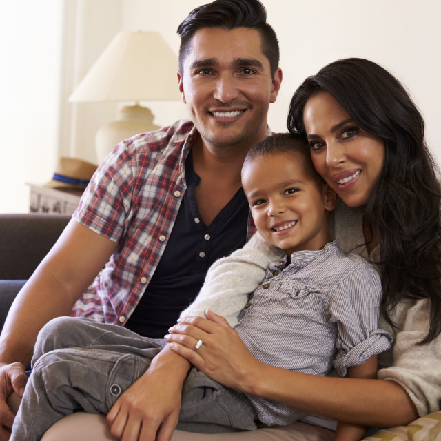 """""""Portrait Of Happy Family Sitting On Sofa In at Home"""" stock image"""