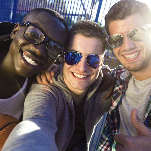 """""""Group of friends taking a selfie after playing basketball."""" stock image"""