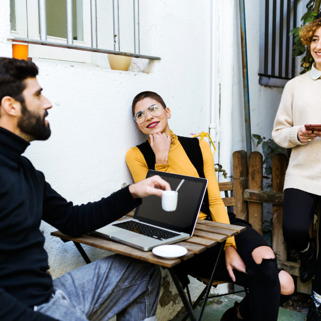"""""""Friends using gadgets in cafe"""" stock image"""