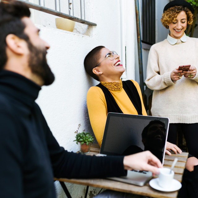 """""""Group of friends using gadgets in cafe"""" stock image"""