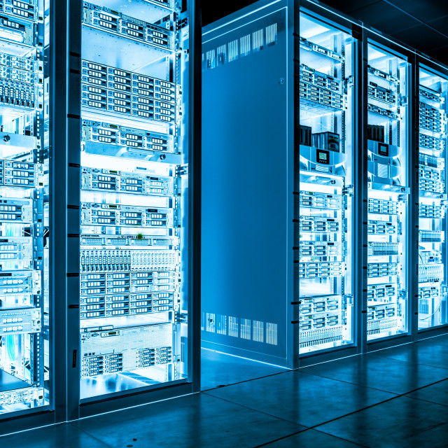 """Big data dark server room with bright equipment"" stock image"