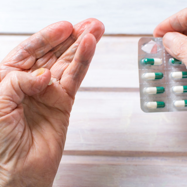 """""""Senior woman hands taking out pill"""" stock image"""