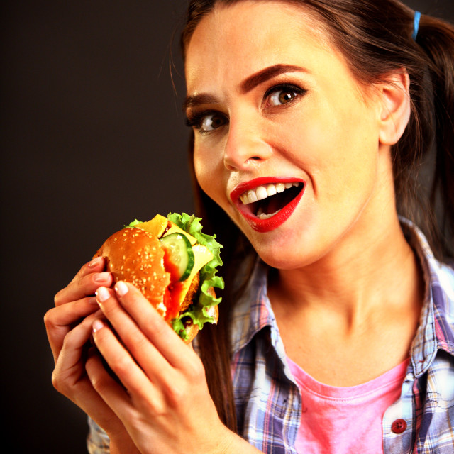 """Woman eating hamburger. Girl wants to eat burger."" stock image"