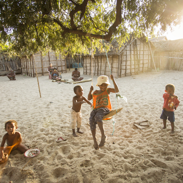 """MADAGASCAR, MORONDAVA - OCTOBER 4, 2016: Unknown children playing with joy in..."" stock image"