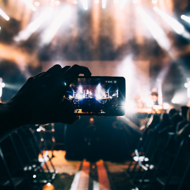 """""""Taking photos of a concert"""" stock image"""