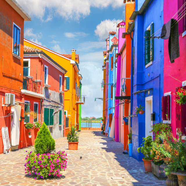 """Multicolor houses with fantastic sky in background"" stock image"