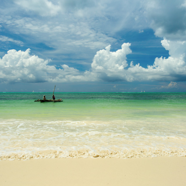 """Traditional Zanzibar fishing boat on a beautiful landscape with white clouds,..."" stock image"