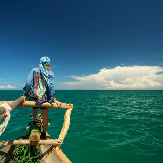 """Woman enjoying time on the traditional fisher boat in Zanzibar"" stock image"