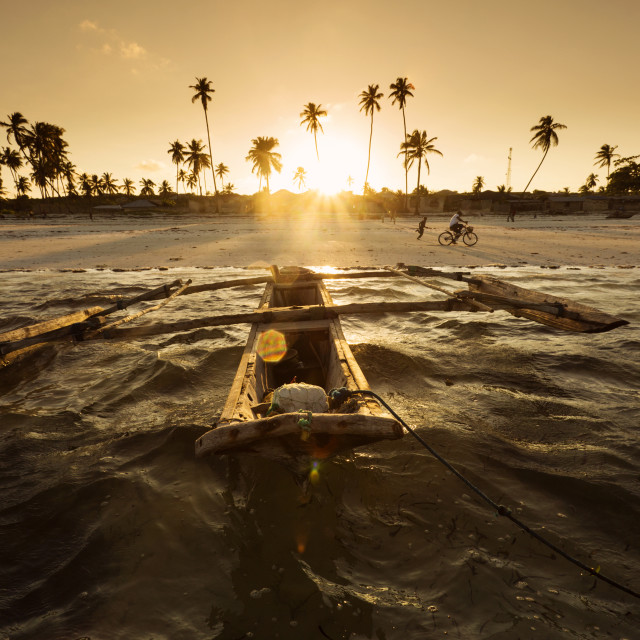 """Traditional fishing boat floating on ocean at beautiful sunset in Zanzibar,..."" stock image"
